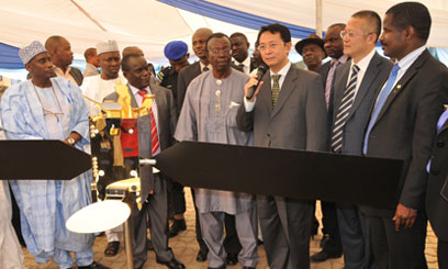 Chinese ambassador to Nigeria Deng Boqing (5th R) speaks in front of a satellite model in capital of Abuja Photo: capitalfm.ko.ke